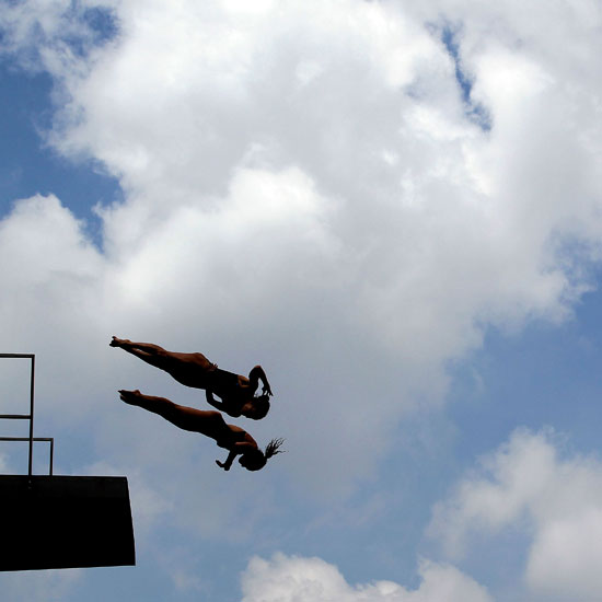 Villo Kormos and Zsofia Reisinger of Hungary compete in the 10-meter synchronized platform diving event in the FINA World Championships in Shanghai, China.