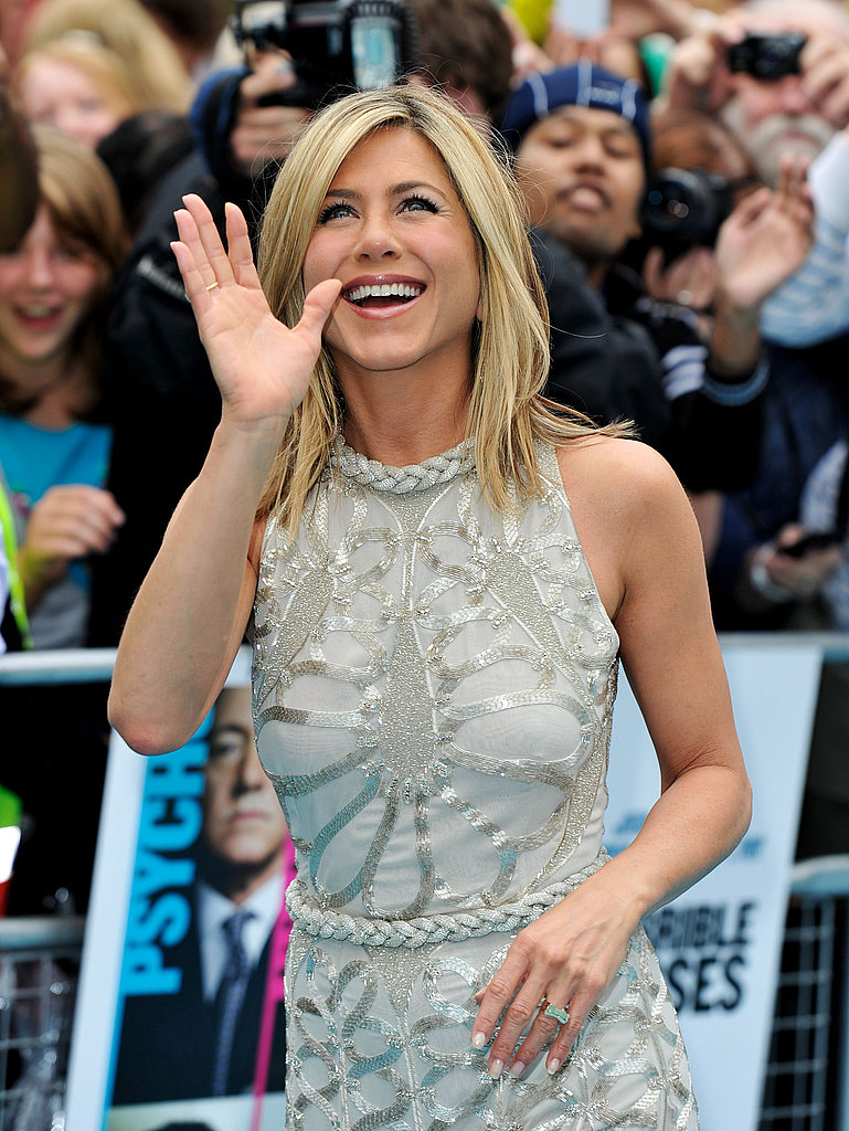 Jennifer Aniston waves at London Horrible Bosses premiere.
