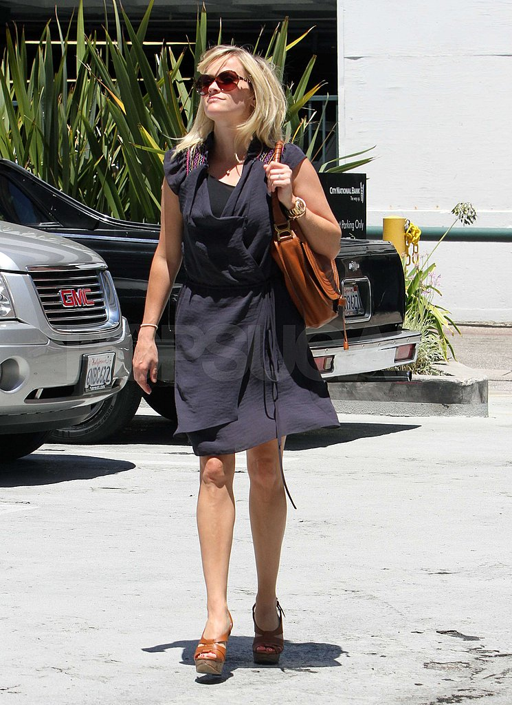 Reese Witherspoon showed off her legs in platform sandals.