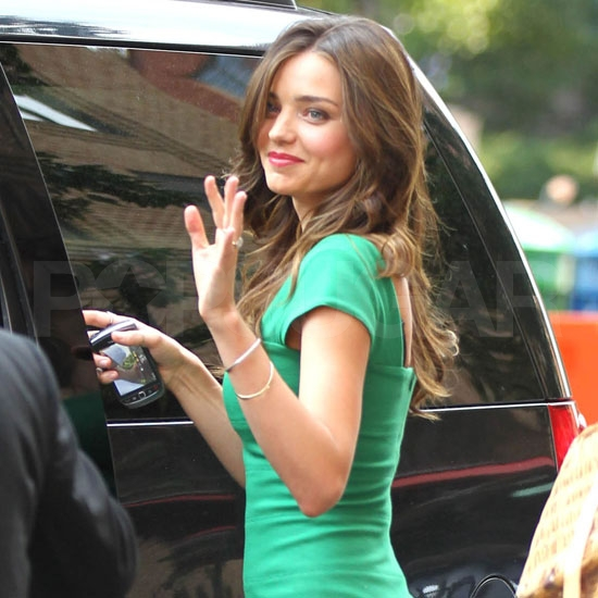 Miranda Kerr in a green mini.