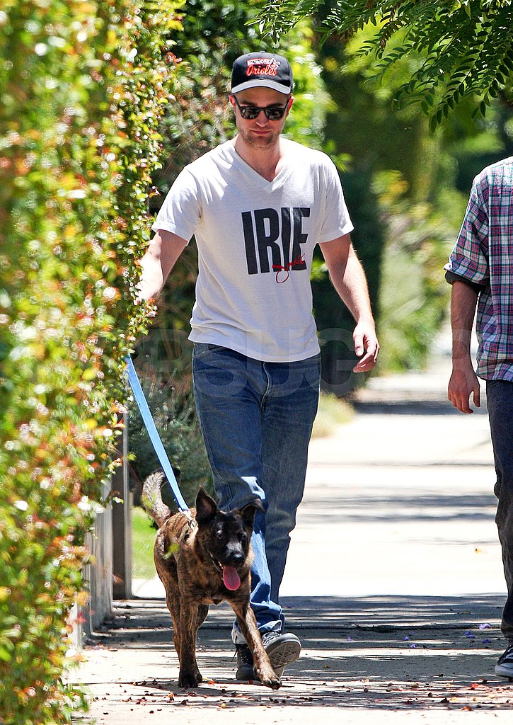 Robert Pattinson with his dog.