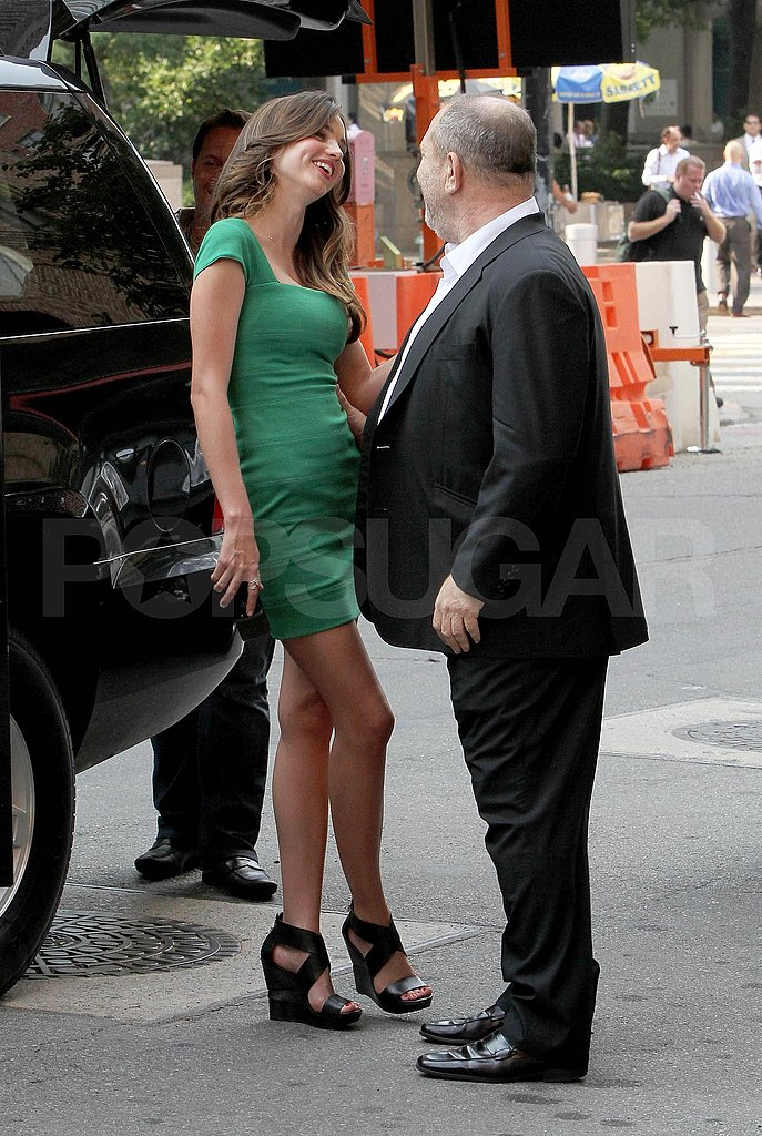 Miranda Kerr chats with Harvey Weinstein.