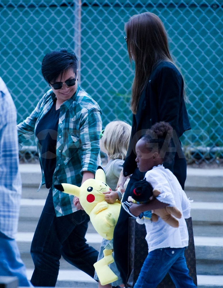 Angelina Jolie holds hands with Shiloh Jolie-Pitt and Zahara Jolie-Pitt.