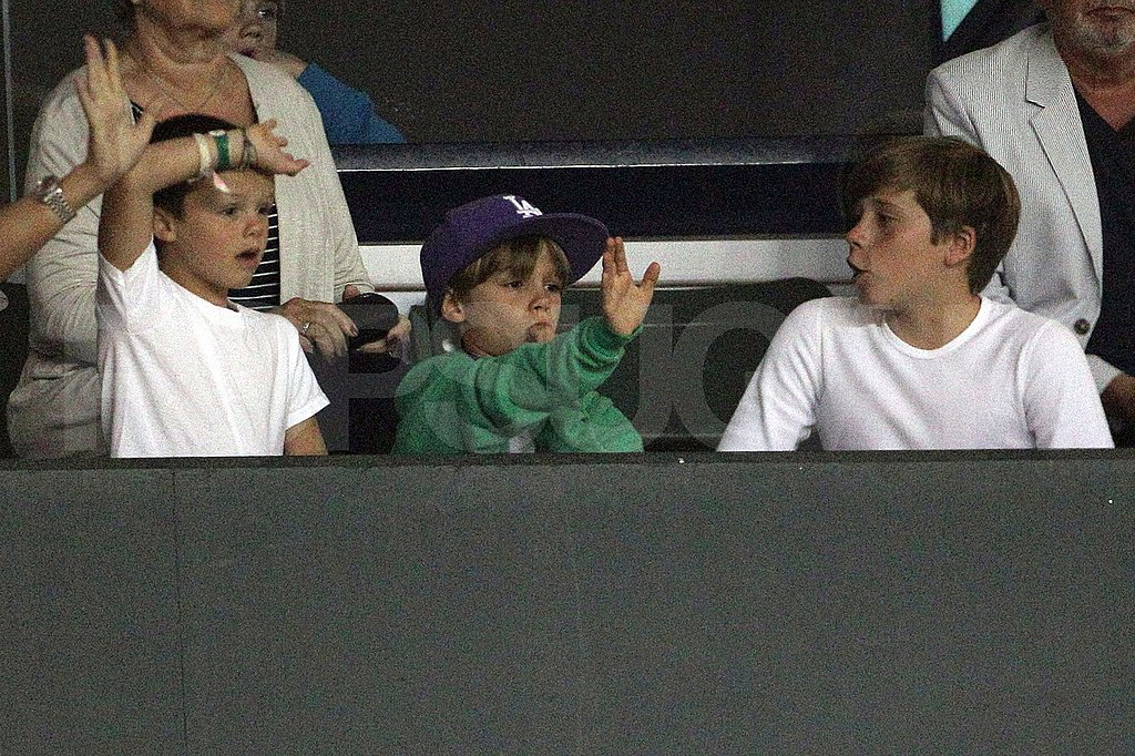 Romeo, Cruz, and Brooklyn Beckham at a soccer game.