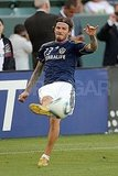 David Beckham kicks a soccer ball.