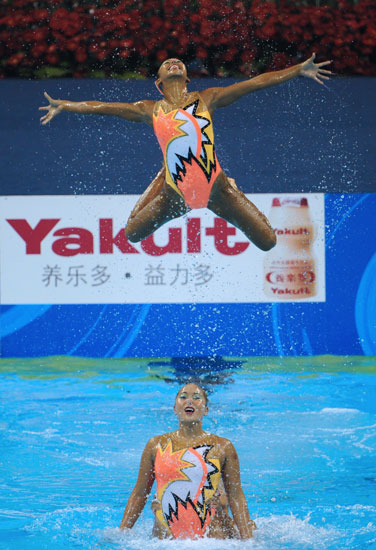 Singapore's synchronized swimmers perform with a smile at the FINA World Championships in China.