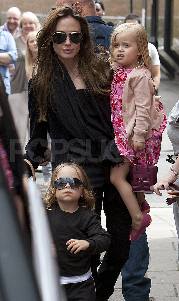 Angelina Jolie leaves movies with sunglasses-wearing Knox and Vivienne.