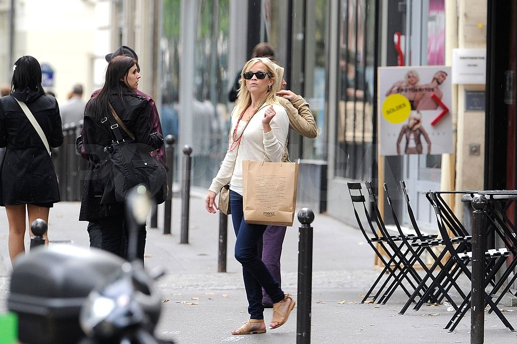 Reese Witherspoon and Jim Toth went shopping in Paris.