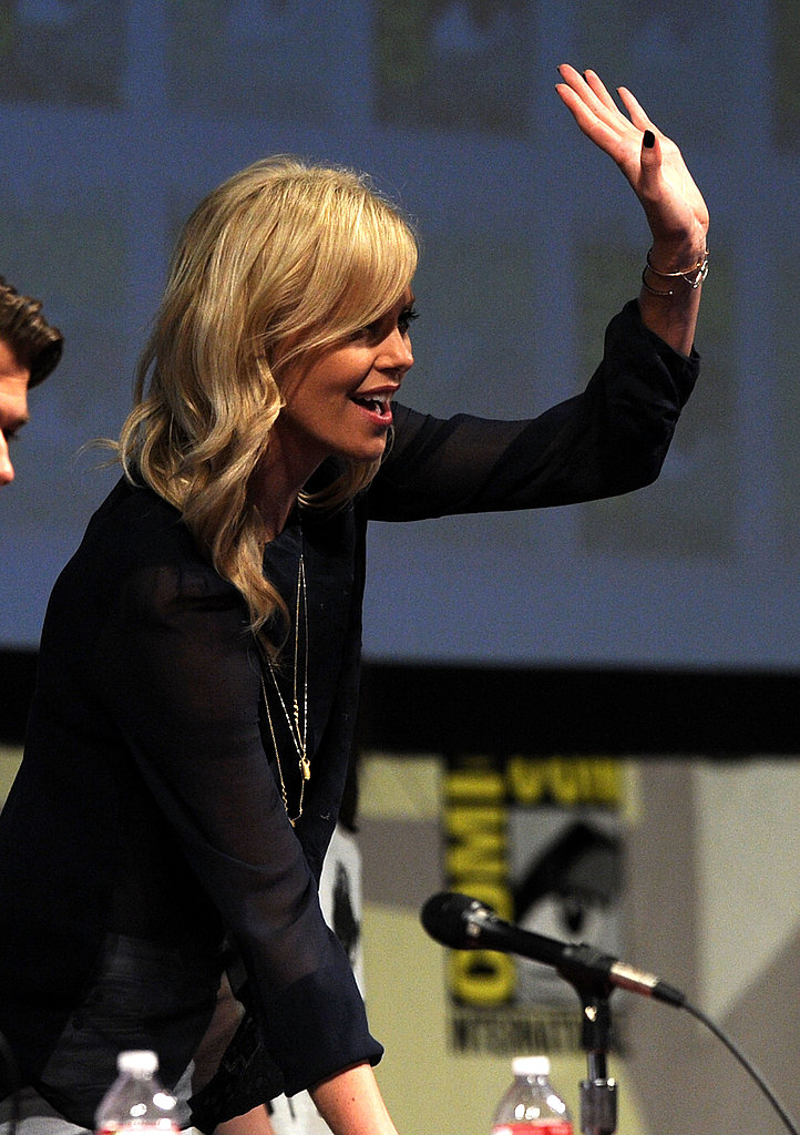 Charlize Theron waved to fans.