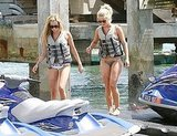 Julianne Hough and Ashley Tisdale in life vests.