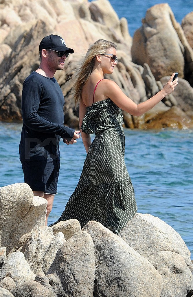 Bar Refaeli and David Fisher snapped pictures.