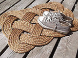 Nautical rope is also a staple in beach homes, but don't let the motif become a cliché. Pick up something simple and unusual like the Square Nautical Doormat ($80) and leave it at that.
