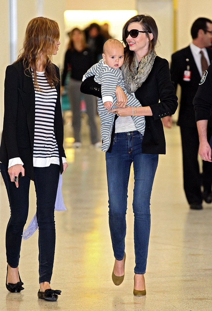 Miranda Kerr held on to Flynn Bloom walking through the airport.