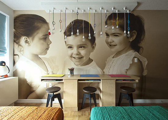 To celebrate the triplets, the Novogratzes had a photographer take candid portraits of the kids. The images were then converted into wallpaper by Duggal, a digital printing firm. The dangling NUD light fixtures add some unique and kid-friendly light to the room.