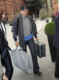 Bradley Cooper toted a suitcase and garment bag.