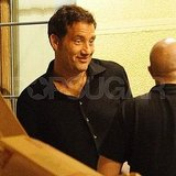 Clive Owen laughs with pals.