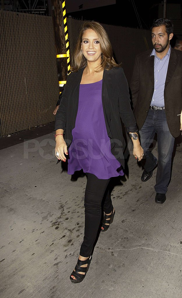 Jessica Alba chose a purple top and black pants.