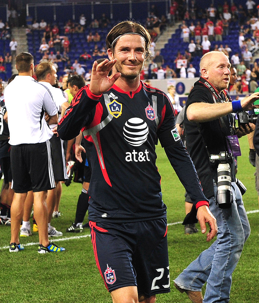 David Beckham waves to fans.