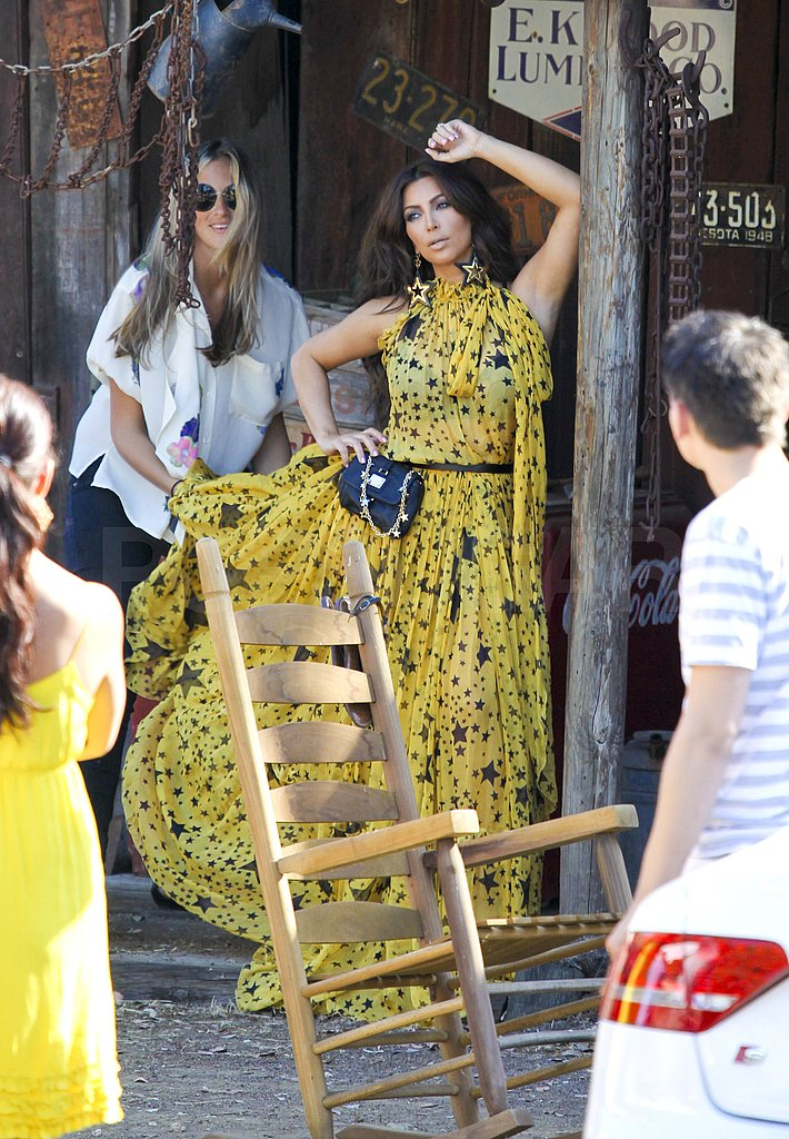 Kim Kardashian wore a yellow printed dress.