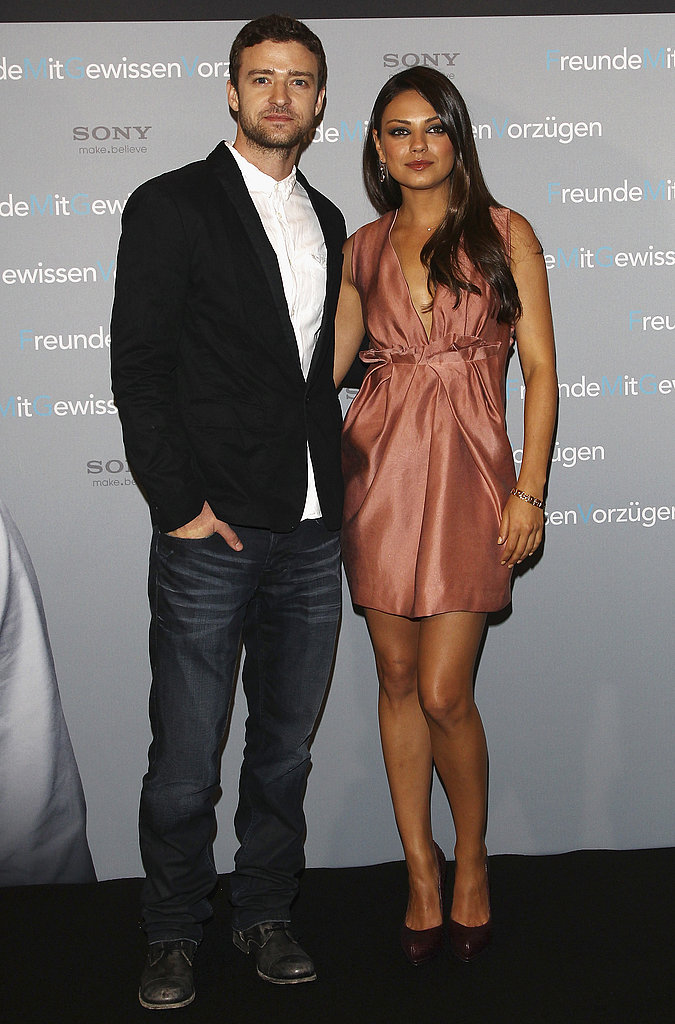 Mila Kunis and Justin Timberlake posed on the black carpet.