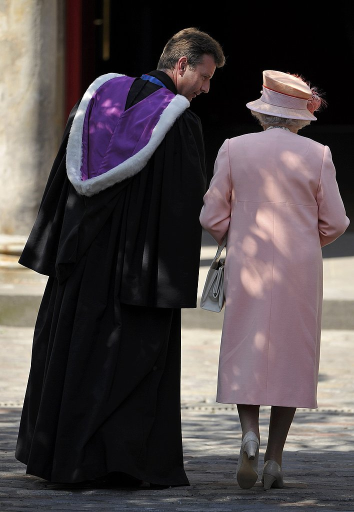 Queen Elizabeth II talks to the Reverend Neil Gardner at the wedding of her granddaughter Zara Phillips.