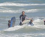 The Beckham boys held on tight to their boards.