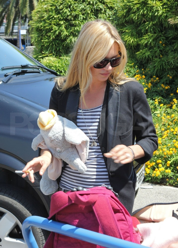 Kate Moss with her daughter's toy in Paris.