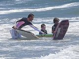David helped Cruz and Romeo get ready to surf.