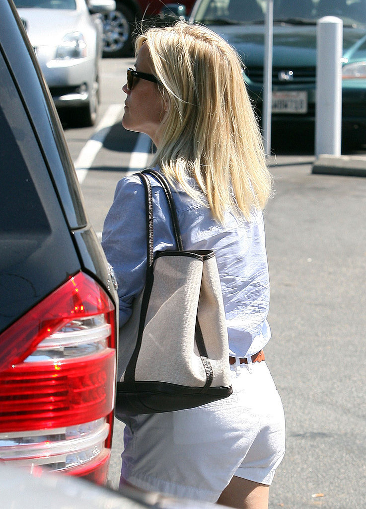 Reese Witherspoon at her car.