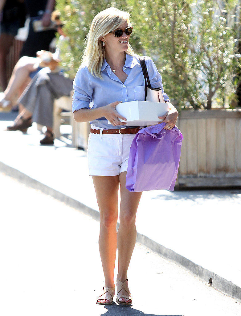 Reese Witherspoon in white shorts.
