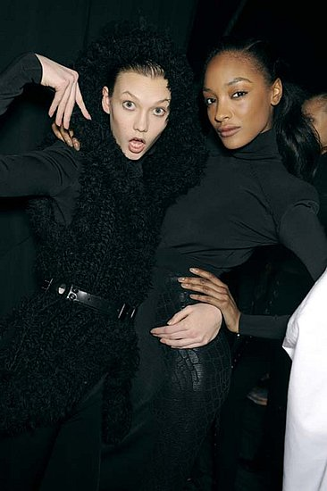 Expressive faces did all the work while Karlie and Jourdan were dressed in black on a matching background. Source: Greg Kessler