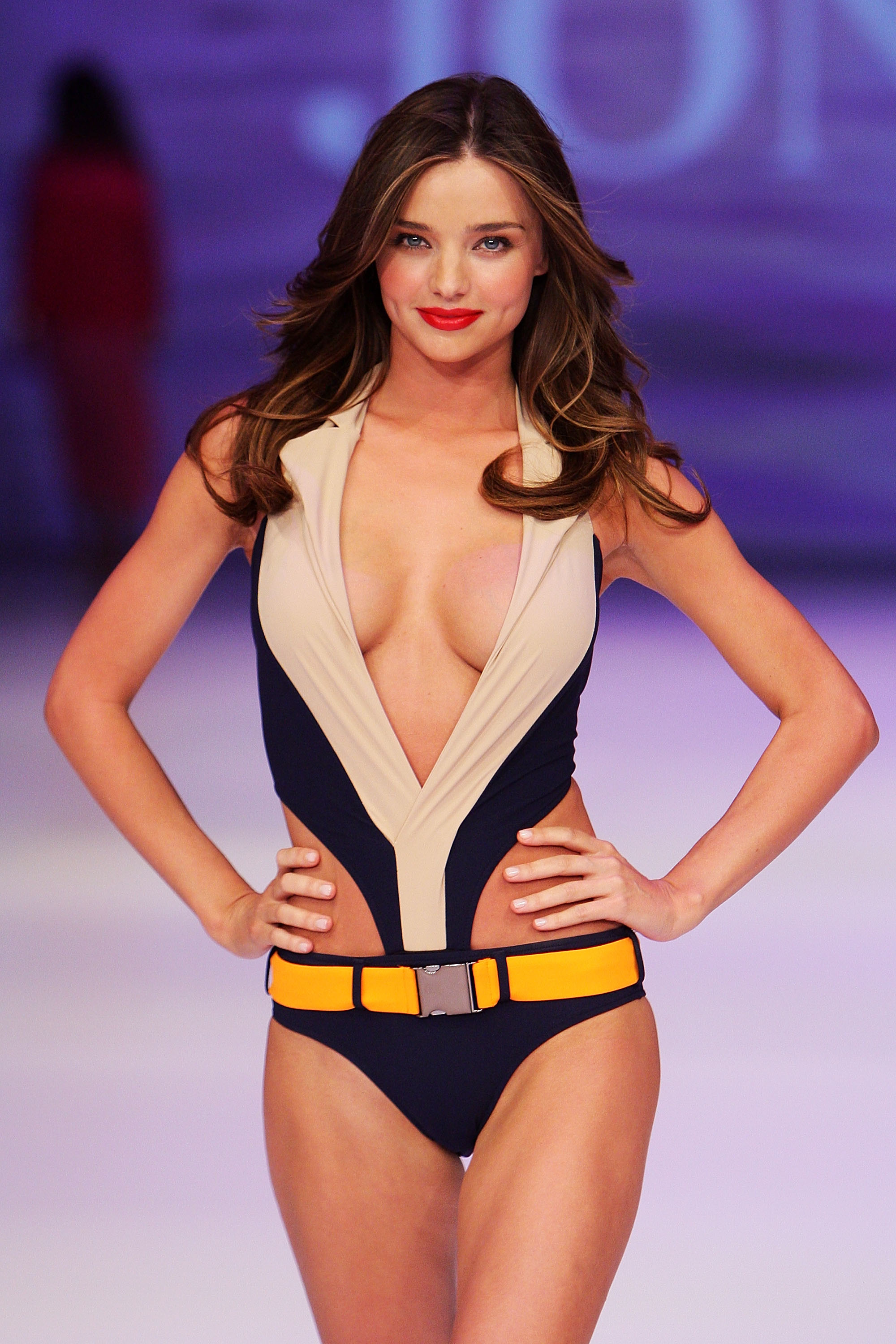Miranda Kerr on the runway in a swimsuit.
