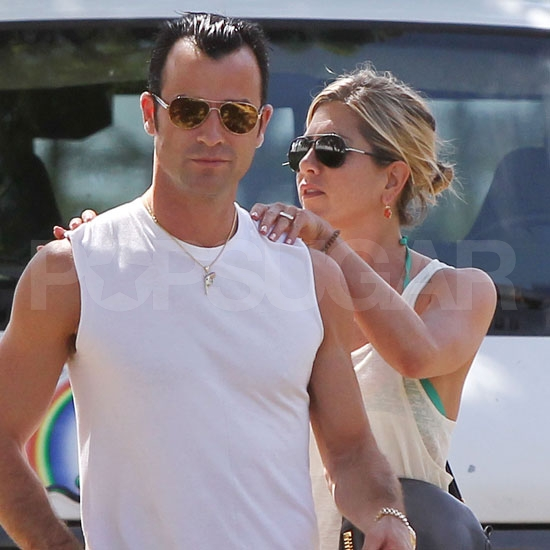 Jennifer Aniston and Justin Theroux show PDA.