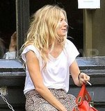 Sienna Miller riffled through her bag.