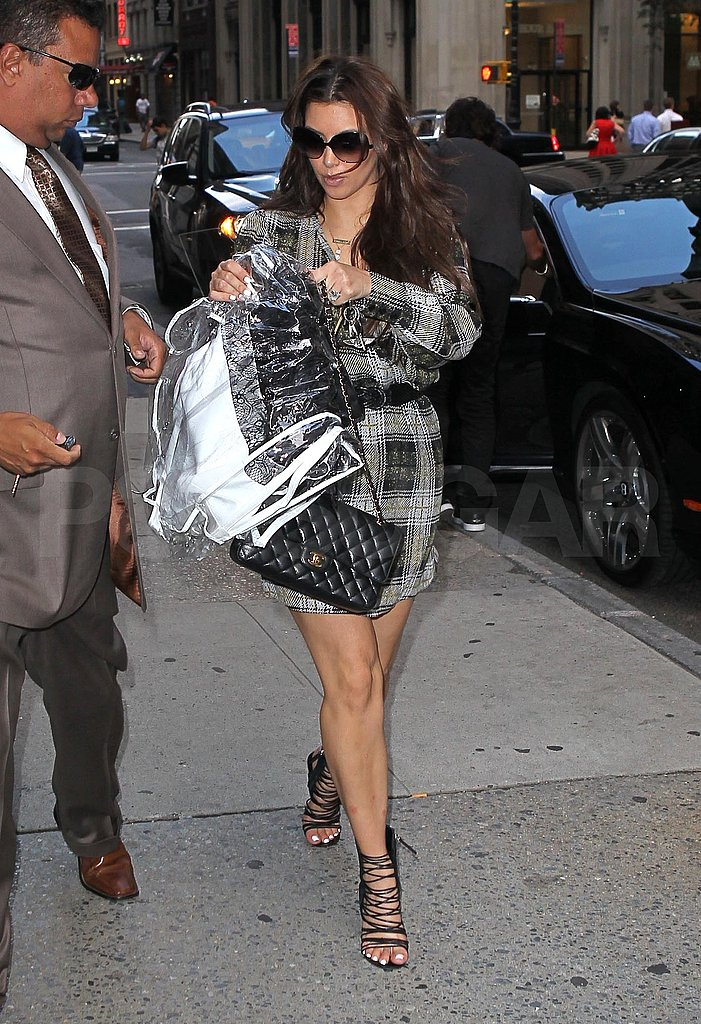 Kim Kardashian carried a garment bag.
