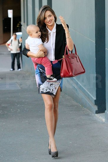 Miranda Carries Flynn as She Strolls the Sydney Streets