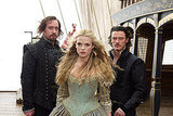 Gabriella Wilde as Constance, Luke Evans as Aramis, and Matthew McFayden as Athos in The Three Musketeers.
