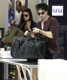 Ian Somerhalder heads out with Nina Dobrev.