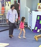 Tom Cruise and Suri Cruise play in NYC.
