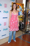 Experimenting with the dress over jeans look in March 2004 at the Ella Enchanted premiere.