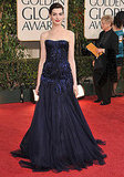 She stuns in navy beaded Armani Privé at the 2009 Golden Globes.