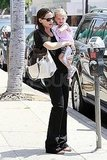 Jennifer Garner carries Seraphina Affleck.