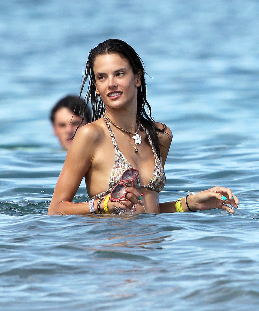Alessandra Ambrosio swims in a bikini.