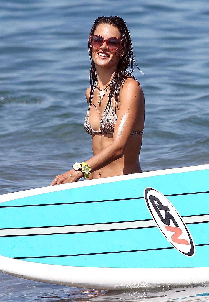 Alessandra Ambrosio with her surfboard.