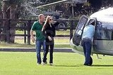 Angelina Jolie boards a helicopter.