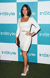 Olivia Munn in a white-hot long sleeved dress and reptilian pumps.
