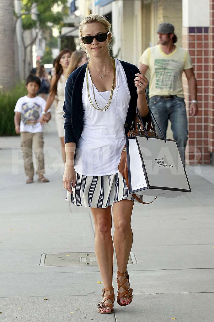Reese layered her white tops and a cardigan.
