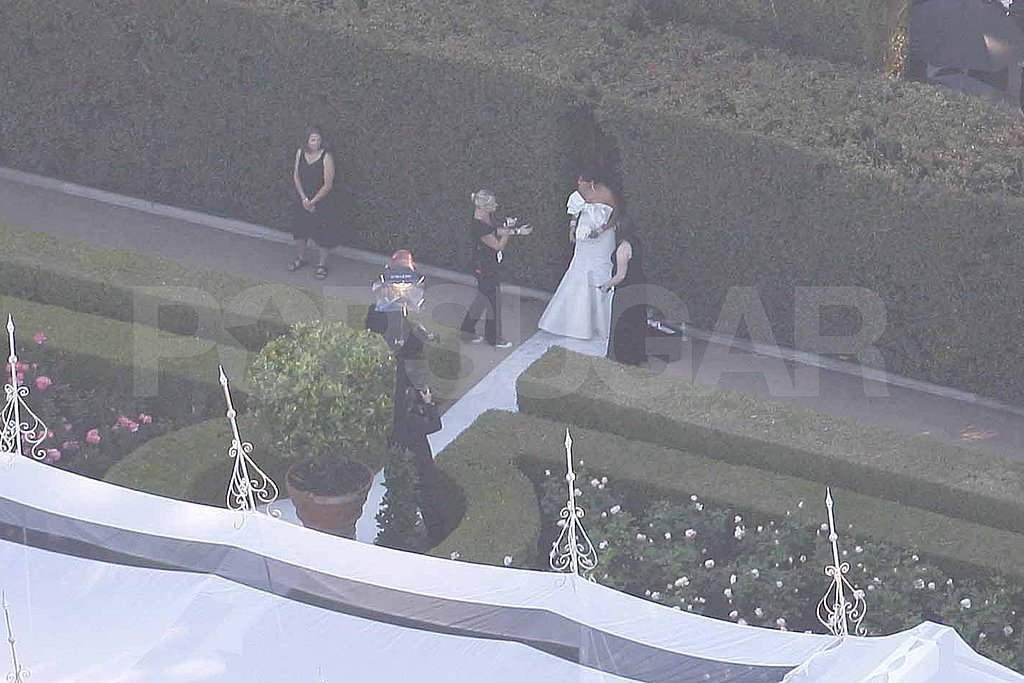 Kris Jenner in white at Kim Kardashian's wedding.
