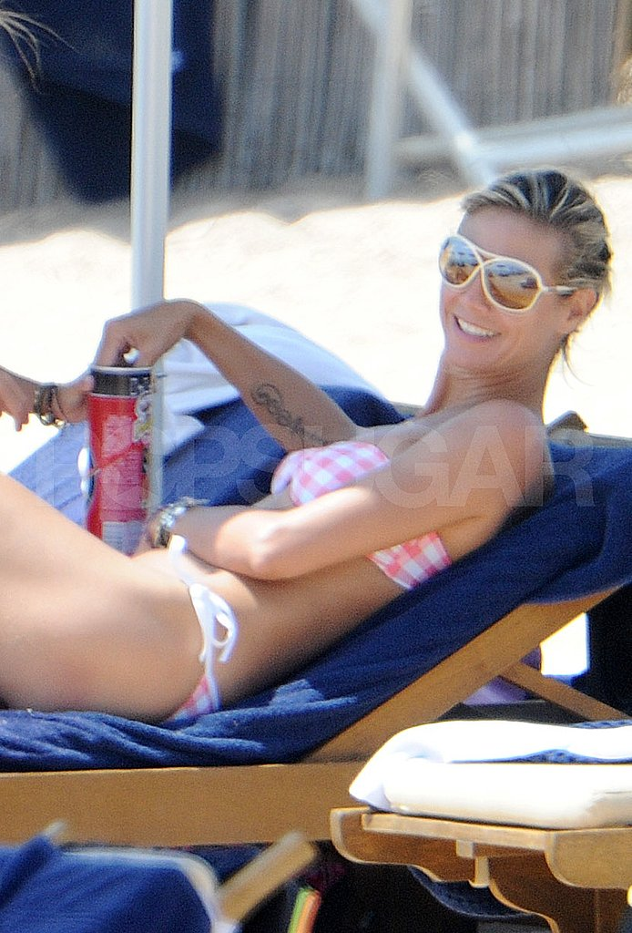 Heidi Klum snacks on the beach.