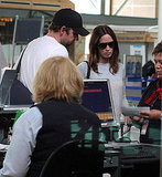 Emily Blunt and John Krasinski check in for a flight.